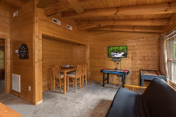 Game room on the upper floor at Laid Back, a 2 bedroom cabin rental located in Pigeon Forge