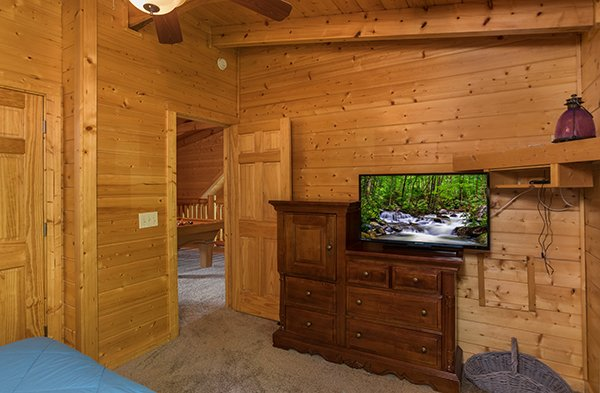 Dresser and television in the loft bedroom at Laid Back, a 2 bedroom cabin rental located in Pigeon Forge