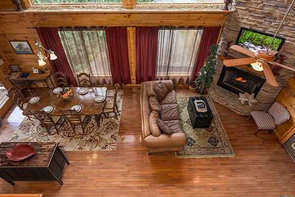 Open concept main floor as seen from the game loft at Laid Back, a 2 bedroom cabin rental located in Pigeon Forge