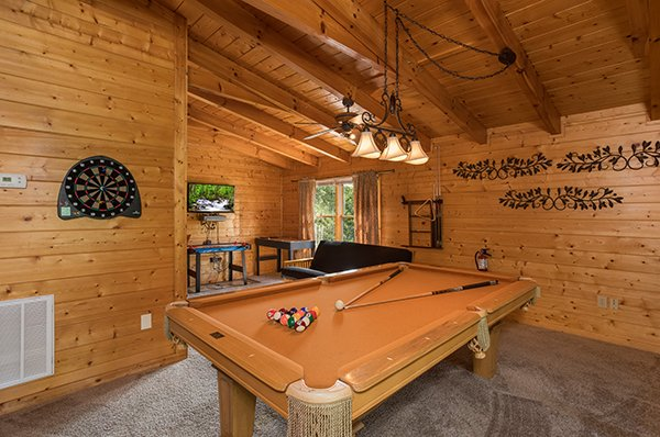 Lofted game room with pool, darts, and air hockey at Laid Back, a 2 bedroom cabin rental located in Pigeon Forge