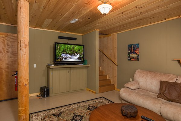 TV in the downstairs theater room at Laid Back, a 2 bedroom cabin rental located in Pigeon Forge