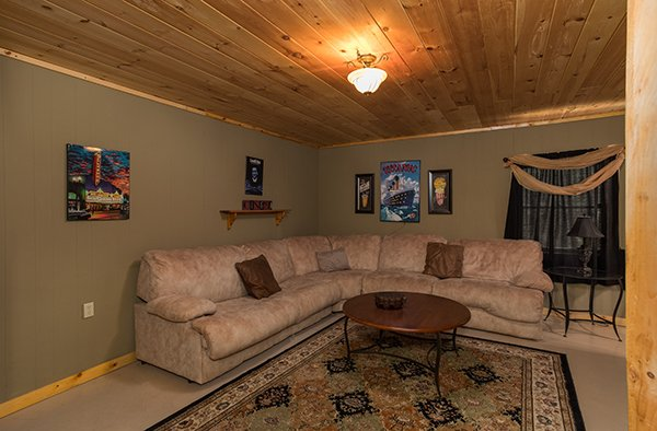 Large sectional sofa in the theater room at Laid Back, a 2 bedroom cabin rental located in Pigeon Forge