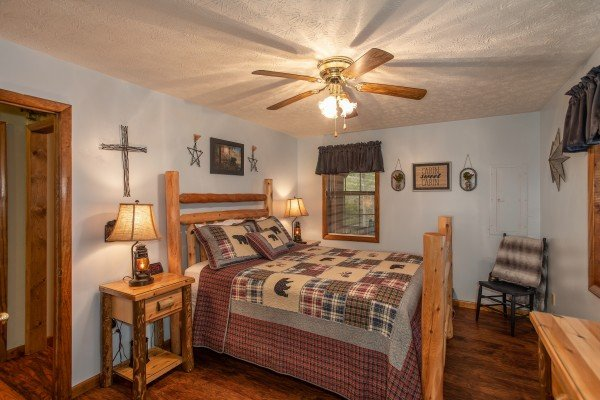 Bedroom with a queen log bed at Black Bear Holler, a cabin rental in Pigeon Forge
