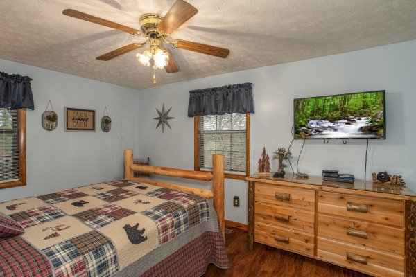 Bedroom with a dresser and TV at Black Bear Holler, a cabin rental in Pigeon Forge