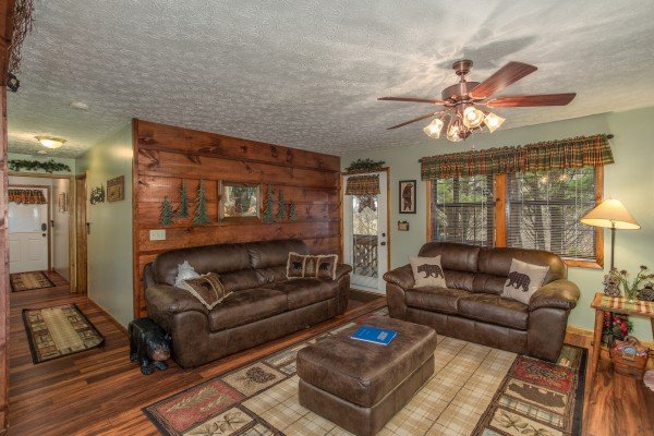 Sofa and loveseat in the living room at Black Bear Holler, a cabin rental in Pigeon Forge