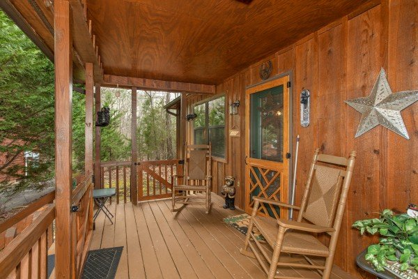 Rocking chairs on the porch at Black Bear Holler, a cabin rental in Pigeon Forge