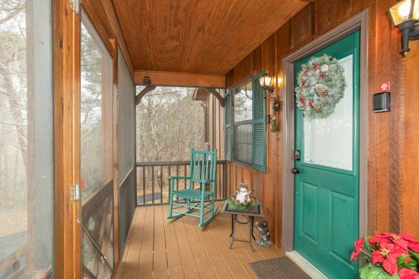 Rocking chair on a screened porch at Black Bear Holler, a cabin rental in Pigeon Forge