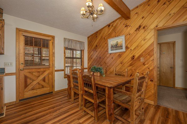 Dining space for six at Pampered Campers, a 3 bedroom cabin rental located in Pigeon Forge