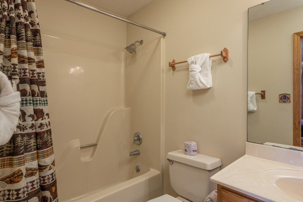 Bathroom with tub and shower at Pampered Campers, a 3 bedroom cabin rental located in Pigeon Forge