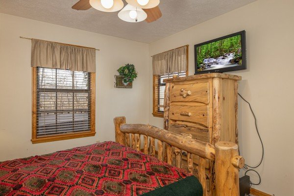 Dresser with TV at Pampered Campers, a 3 bedroom cabin rental located in Pigeon Forge