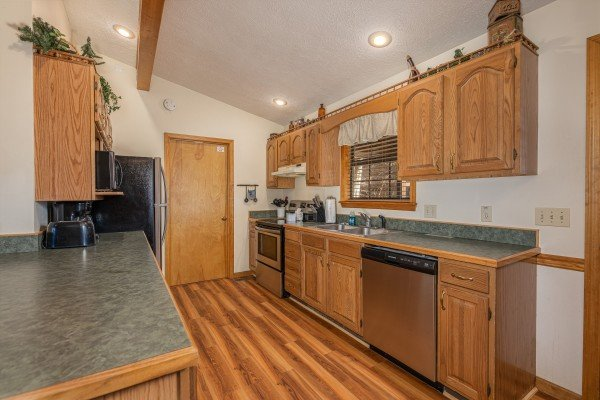 Kitchen with stainless appliances at Pampered Campers, a 3 bedroom cabin rental located in Pigeon Forge
