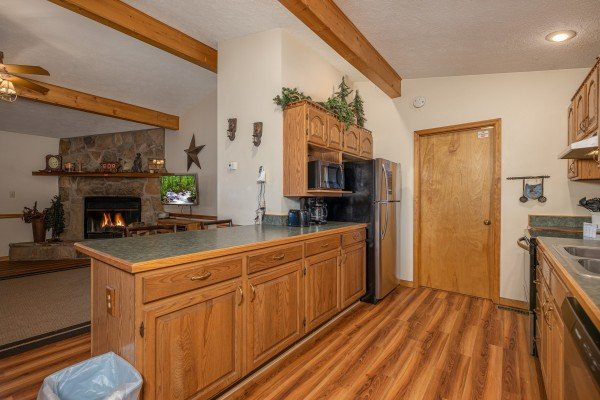 Long bar top counter in a kitchen with stainless appliances at Pampered Campers, a 3 bedroom cabin rental located in Pigeon Forge