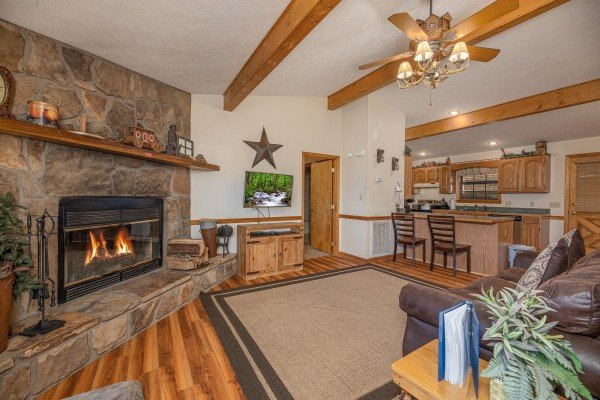 Living room and adjacent dining space at Pampered Campers, a 3 bedroom cabin rental located in Pigeon Forge