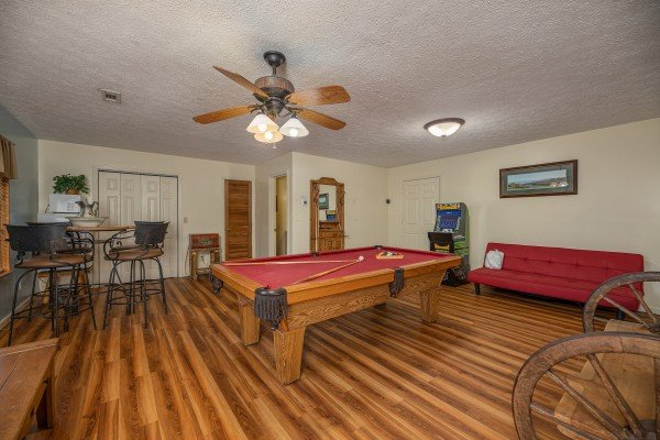 Red felt pool table in the game space at Pampered Campers, a 3 bedroom cabin rental located in Pigeon Forge