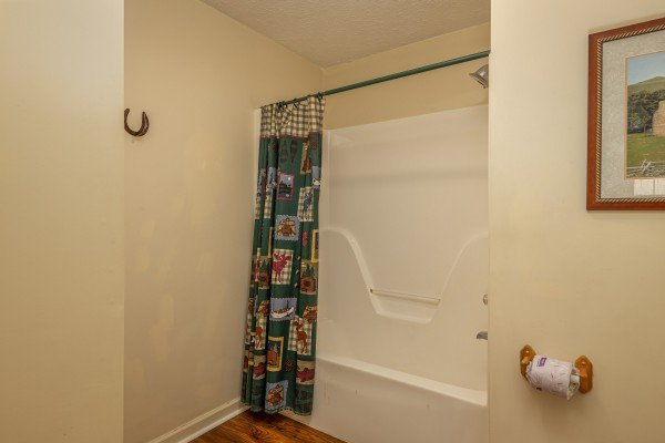 Bathroom with a tub and shower at Pampered Campers, a 3 bedroom cabin rental located in Pigeon Forge