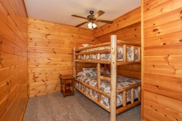 Log bunk bed in the bunk room at The Cowboy Way, a 4 bedroom cabin rental located in Pigeon Forge
