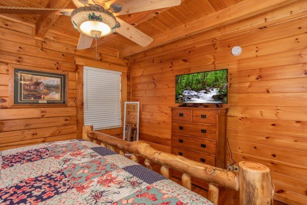 Dresser with TV in a bedroom at The Cowboy Way, a 4 bedroom cabin rental located in Pigeon Forge