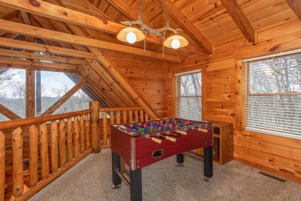 Foosball table in the loft at The Cowboy Way, a 4 bedroom cabin rental located in Pigeon Forge