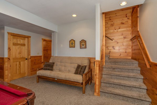 Futon in the game room at The Cowboy Way, a 4 bedroom cabin rental located in Pigeon Forge