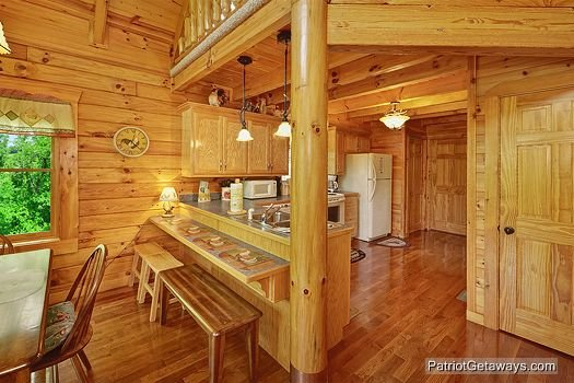 Kitchen island with breakfast bar at The Cowboy Way, a 4 bedroom cabin rental located in Pigeon Forge