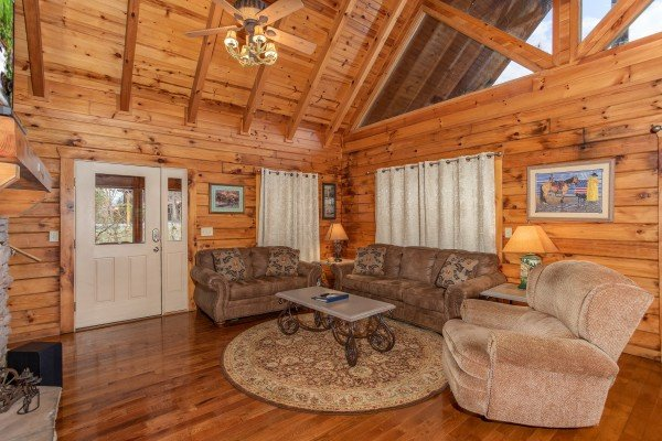 Living room with sofa, loveseat, and recliner at The Cowboy Way, a 4 bedroom cabin rental located in Pigeon Forge