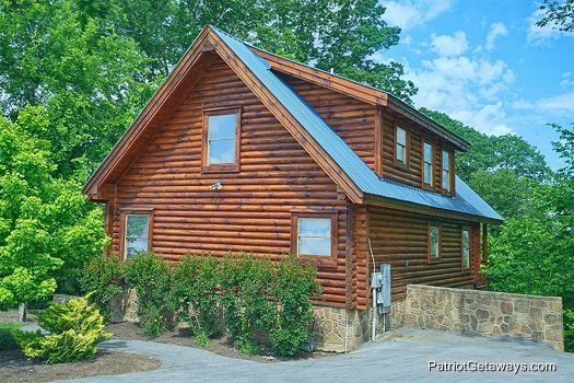 Side exterior view of the cabin at The Cowboy Way, a 4 bedroom cabin rental located in Pigeon Forge