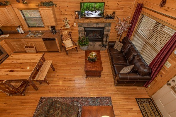 Looking down into the living room at Let the Good Times Roll, a 2 bedroom cabin rental located in Pigeon Forge