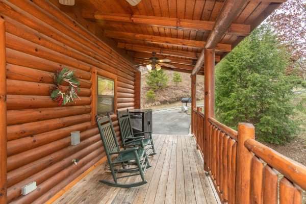 Covered porch with rocking chairs at Let the Good Times Roll, a 2 bedroom cabin rental located in Pigeon Forge