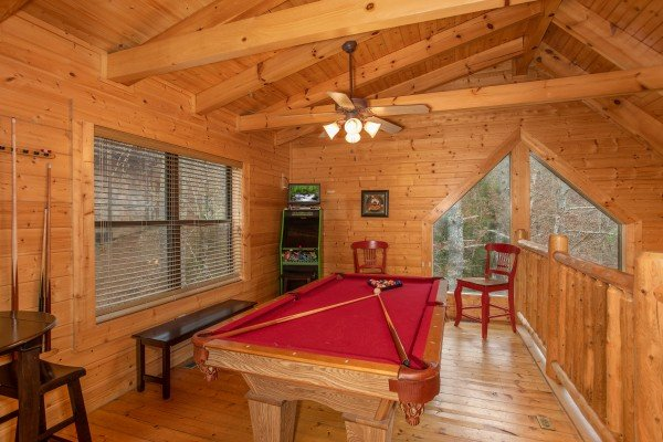 Video game and pool table in the loft at Let the Good Times Roll, a 2 bedroom cabin rental located in Pigeon Forge