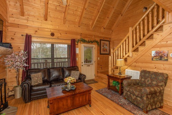 Seating in the living room at Let the Good Times Roll, a 2 bedroom cabin rental located in Pigeon Forge