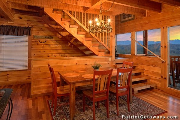 Dining space for four at The Big View, a 4 bedroom cabin rental located in Pigeon Forge