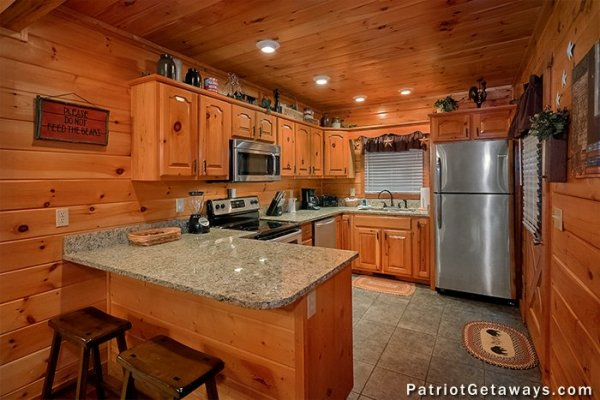 Kitchen with granite counters and stainless appliances at The Big View, a 4 bedroom cabin rental located in Pigeon Forge