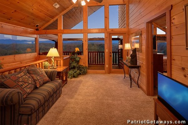 Loft space with sofa and TV at The Big View, a 4 bedroom cabin rental located in Pigeon Forge