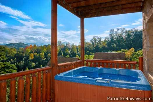 First floor deck with hot tub at The Big View, a 4 bedroom cabin rental located in Pigeon Forge