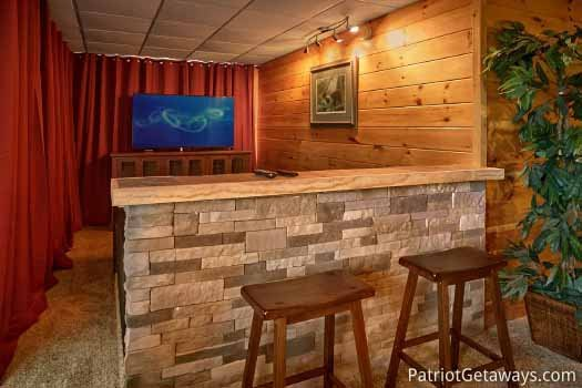 Game room with bar at The Big View, a 4 bedroom cabin rental located in Pigeon Forge