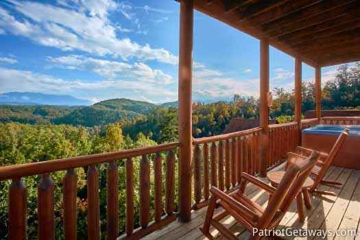 Lower level deck with rockers at The Big View, a 4 bedroom cabin rental located in Pigeon Forge