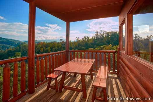 Main level deck with picnic area at The Big View, a 4 bedroom cabin rental located in Pigeon Forge
