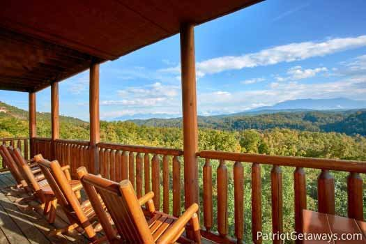 Main level deck with rockers at The Big View, a 4 bedroom cabin rental located in Pigeon Forge