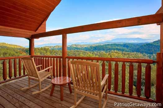 Third floor deck with rockers at The Big View, a 4 bedroom cabin rental located in Pigeon Forge