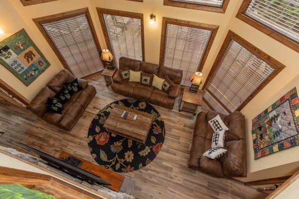 Looking down into the living room from the upper floor at Over Ober Lodge, a 5 bedroom cabin rental located in Gatlinburg