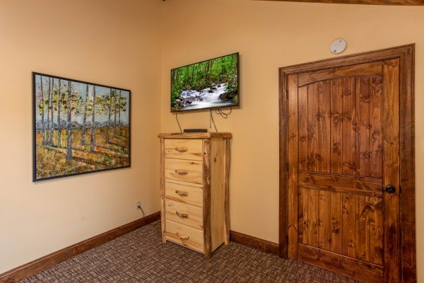 Dresser and TV in a bedroom at Over Ober Lodge, a 5 bedroom cabin rental located in Gatlinburg