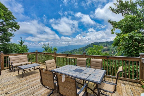 Dining space for six on the deck at Over Ober Lodge, a 5 bedroom cabin rental located in Gatlinburg