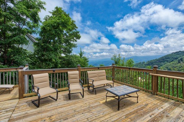 Deck seating at Over Ober Lodge, a 5 bedroom cabin rental located in Gatlinburg