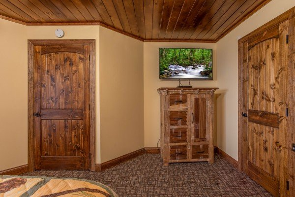 Bedroom with armiore and TV at Over Ober Lodge, a 5 bedroom cabin rental located in Gatlinburg