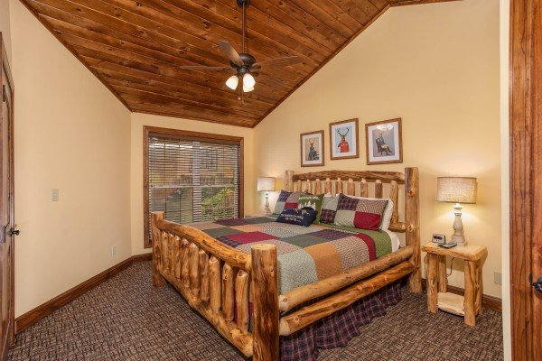 Bedroom with a king sized log bed at Over Ober Lodge, a 5 bedroom cabin rental located in Gatlinburg
