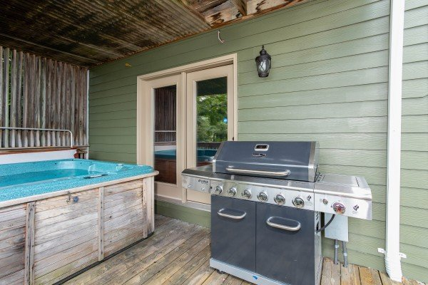 Hot tub and grill at Over Ober Lodge, a 5 bedroom cabin rental located in Gatlinburg