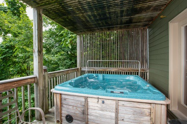 Hot tub with privacy fence at Over Ober Lodge, a 5 bedroom cabin rental located in Gatlinburg