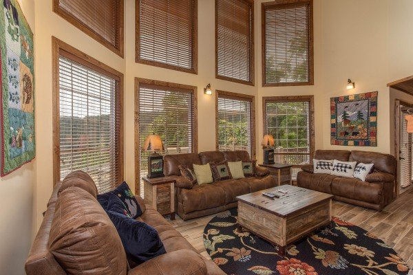 Living room with high ceiling and large windows at Over Ober Lodge, a 5 bedroom cabin rental located in Gatlinburg