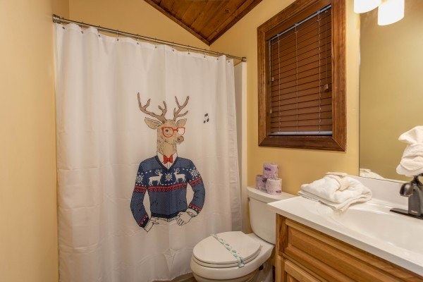 Bathroom with a tub and shower at Over Ober Lodge, a 5 bedroom cabin rental located in Gatlinburg