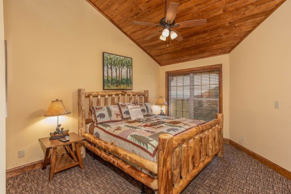 Bedroom with a king log bed at Over Ober Lodge, a 5 bedroom cabin rental located in Gatlinburg